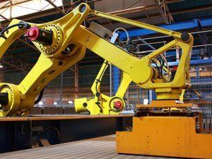 000008422996_production-line-robots-picking-up-bricks-on-a-conveyor_istock_gl497x373