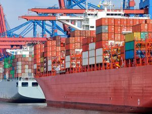 000045052888_cargo-ship-shipping-containers-docked-terminal-port-of-hamburg_istock_gl497x373