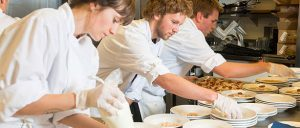 hospitality-restaurant-staff-Plating-Up-food-chefs-kitchen_iStock_NewsFeed_614x261