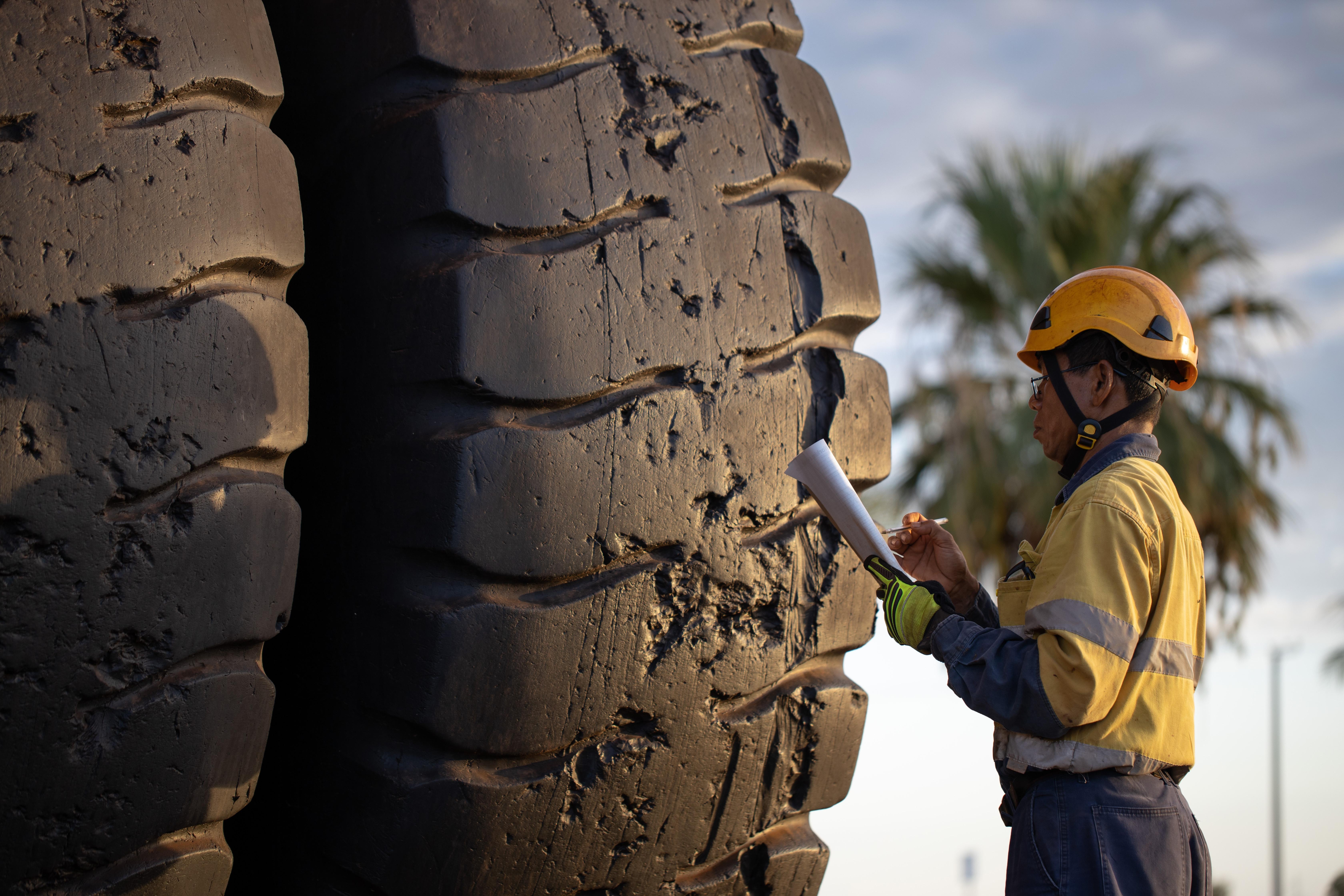Technician Inspecting Truck